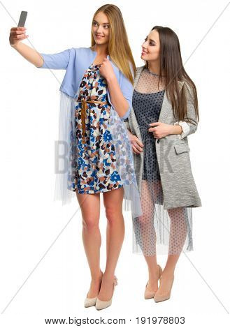 Two young women doing selfie isolated