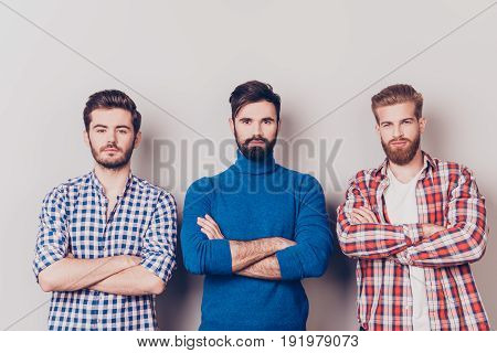 Ethnicity, Multicultural Diversity. Three Serious Harsh Men Are Standing Isolated On Pure Background