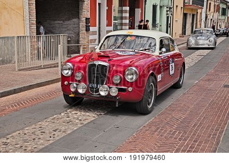 GATTEO, FC, ITALY - MAY 19: driver and co-driver on a vintage Italian car Lancia Aurelia B20 GT 2500 third series(1953) in historical classic car race Mille Miglia, on May 19, 2017 in Gatteo, FC, Italy
