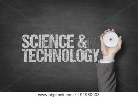 Science and technology text with businessman hand holding cogwheel