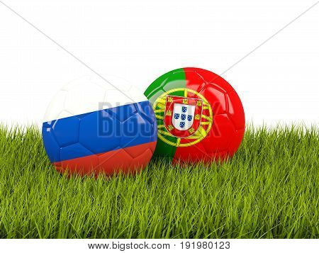 Two Footballs With Flags Of Russia And Portugal On Green Grass