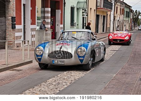 GATTEO, FC, ITALY - MAY 19: the drivers Toto Wolff and Aldo Costa on a competition car Mercedes-Benz 300 SL W194 Prototype (1952) in historical classic car race Mille Miglia, on May 19, 2017 in Gatteo, FC, Italy