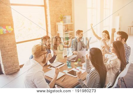 Close Up Of Successful Team Of Business Partners With Raised Up Hands In Light Modern Workstation, C