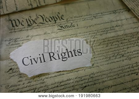 Civil Rights newspaper headline on a copy of the US Constitution
