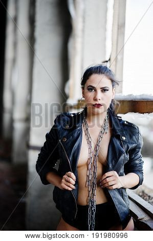 Brunette Plus Size Sexy Woman, Wear At Black Leather Jacket, Lace Panties And Chain At Abadoned Plac