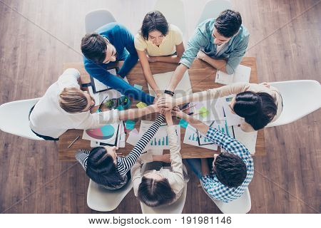 All Together! Conception Of Successful Teambuilding. Topview Of Businesspeople Putting Their Hands O