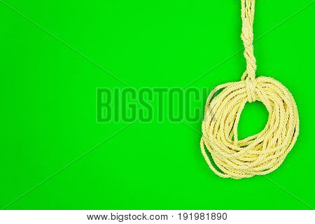 Yellow string put in circle isolated on green background