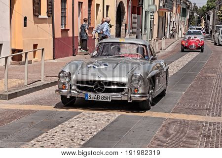 GATTEO, FC, ITALY - MAY 19: the former Formula 1 driver Jochen Mass and Artur Bechtel on Mercedes-benz 300 SL Coupe W198 (1955) in historical classic car race Mille Miglia, on May 19, 2017 in Gatteo, FC, Italy