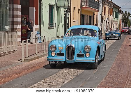 GATTEO, FC, ITALY - MAY 19: driver and co-driver on a vintage French car Talbot Lago T26 GS Berlinette (1950) in historical classic car race Mille Miglia, on May 19, 2017 in Gatteo, FC, Italy
