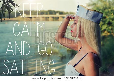 Young retro pinup girl wearing sailor uniform. Keep calm and go sailing.