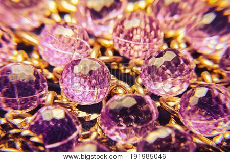 Purple Plastic Jewelry Texture With Golden Chains