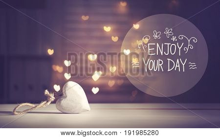 Enjoy Your Day message with a white heart with heart shaped lights