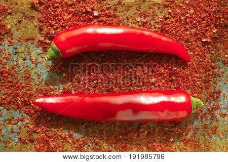 Red hot chili Cayenne pepper fresh and dried powdered spice ready to use on wooden background