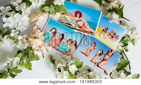 Photo album of beautiful slender young girls in bathing suits and hats on vacation at sea. View from above