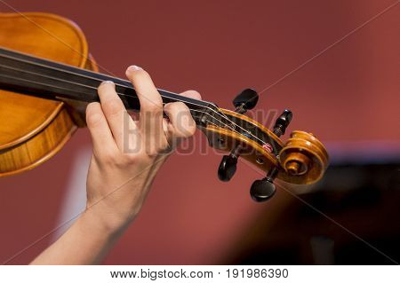 young boy plays violin, concert, athens, greece