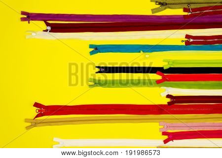 Set of colorful zippers isolated on yellow background
