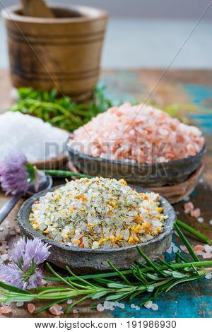 Three Different Types Of Natural Salt In Stone Bowls On Wooden Surface. White Sea Salt, Pink Himalay