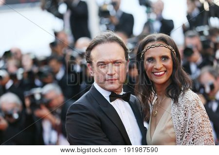 Vincent Perez and Karine Silla attend the 'Based On A True Story' screening during the 70th annual Cannes Film Festival at Palais des Festivals on May 27, 2017 in Cannes, France.