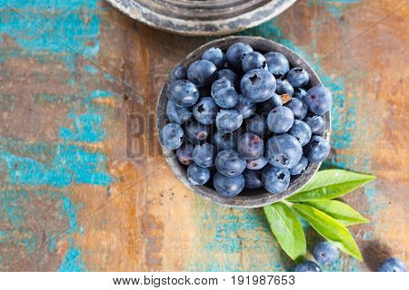 Blueberry antioxidant organic superfood, fresh forest berries on wooden table