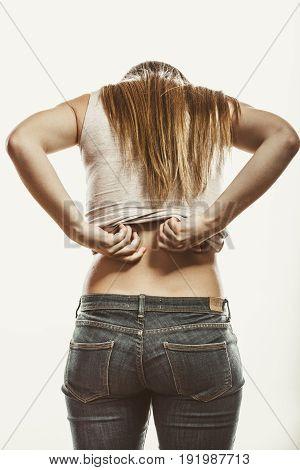 Woman Suffering From Backache Pain.
