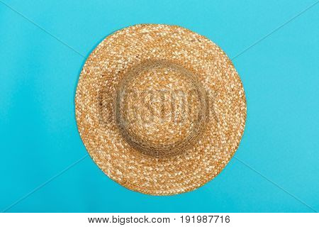 Staw hat on a bright blue background