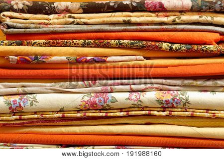 a stack of the beautiful  multicolored fabrics