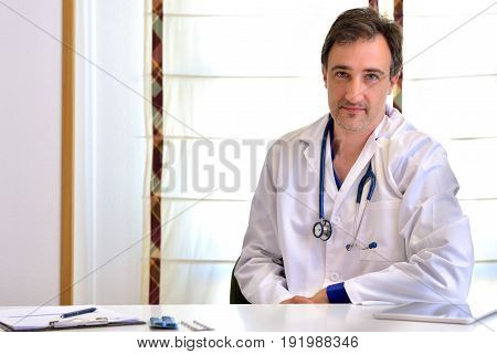 Caucasian General Doctor In Consultation