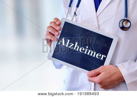 Doctor With Tablet With Alzheimer Message