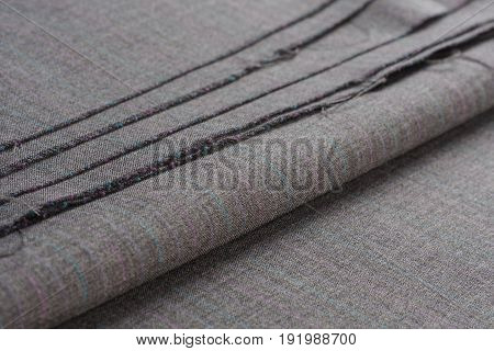 Folds of gray woolen fabric in light colors.