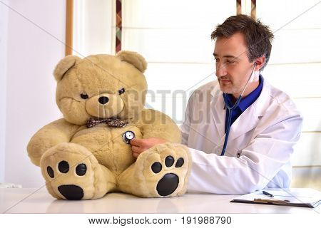 Pediatrician Doctor Auscultating Teddy Side Position