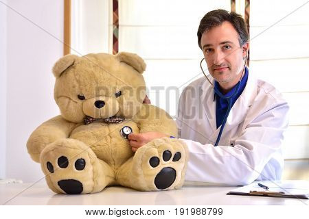 Pediatrician Doctor Auscultating Teddy Front Position