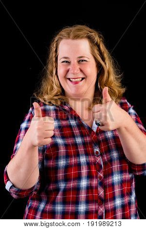 Portrait of a attractive european light overweight red haired female with red lumberjack shirt - view on head, studio shot in from of black background