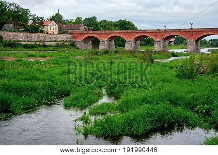 Brick bridge across the River Venta in the city of Kuldiga