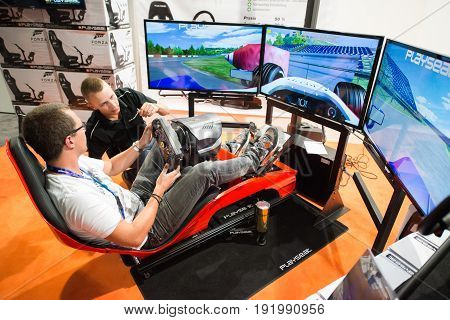 Cologne, Germany, August 13, 2014: Forza presentation with gameseat and drive wheel on gamescon. Gamescom is a trade fair for video games held annually at the Koelnmesse in Cologne.