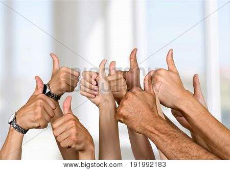 Hands showing thumbs up group close-up multi closeup