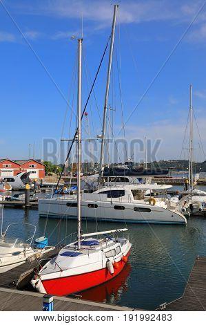 Sailing ships and yachts moored in marina
