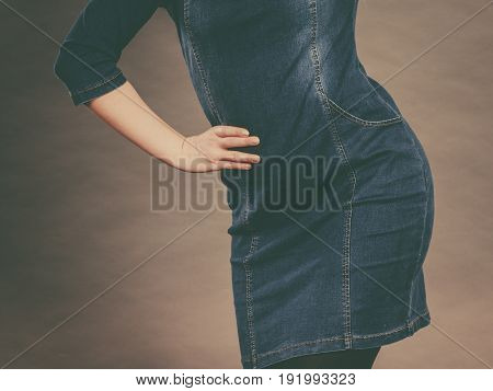 Fashionable outfit ideas trendy clothes concept. Attractive blonde woman wearing tight jeans dress