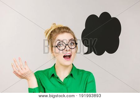 Woman Holding Black Thinking Bubble