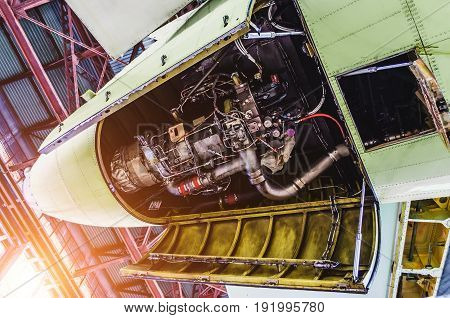 View Of Aircraft Tail And Auxiliary Power Unit.