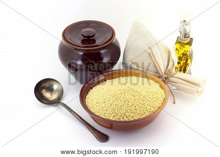 Dry Millet In Ceramic Bowl Isolated On White. Spilled Millet.