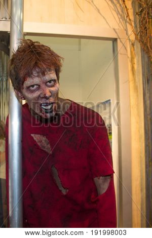 San Diego, CA - July 11, 2015: Zombie actor in the AMC Walking Dead booth at Comic Con 2015 in San Diego, CA.