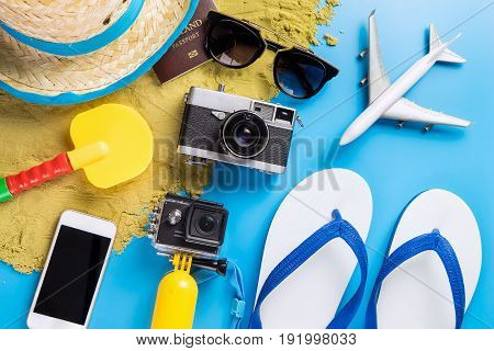 Summer Beach Vacation travel accessories and fashion on blue