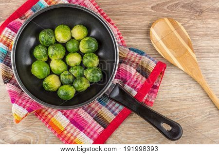 Frying Pan With Brussels Sprouts On Napkin, Wooden Spoon