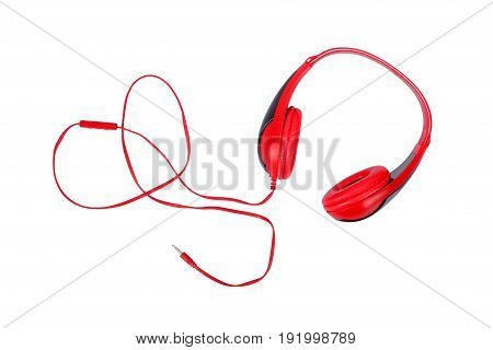 Musical equipment - Red headphone on a white background. Isolated