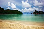 On the white sand tropical beach. Andaman sea. Province Krabi. Koh Phi Phi island. Kingdom Thailand poster