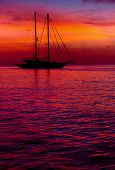 Yacht at Cala Saona in Formentera during the colorful sunset. Idyllic scenery. Balearic Islands. Spain poster