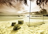Swings on the sand tropical beach. poster