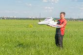 Man with rc fpv model wing. Electronics, hobby, aeromodelling concept poster