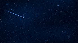 A realistic starry sky with a blue glow. Beautiful shooting star. The meteorite is falling. Shining stars in the dark sky. Background wallpaper for your project. Vector illustration. EPS 10