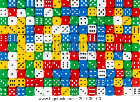 Pattern Background Of Random Ordered Red, White, Yellow, Blue And Green Dices